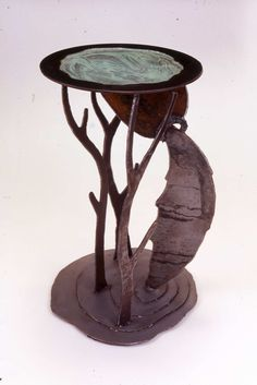 Sculptural stand: 'Water Table' Steel with patinaed coating.