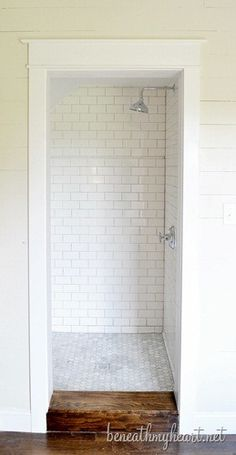 white subway tile shower. grey grout - never dirty?