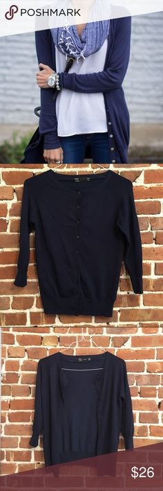 Zara Navy Cardigan Classic cut cardigan. Great for over a dress or with jeans and tee. Button up front. Three quarter sleeve. Soft stretchy fabric. No pils or pulls. Great condition. 17 inches across the chest. Shoulder to hem 24 inches. Zara Sweaters Cardigans