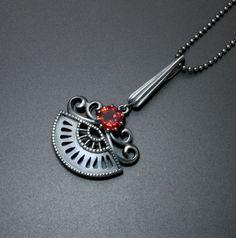 Goth style pendant with a red garnet.   (C) Kazuhiko Ichikawa