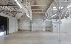 Unique studio for offsites, events, production, retail or art pop ups, rehearsals and photoshoots. Space offers dramatic back drops, high ceilings, exposed brick walls, concrete slab, natural light, triangular pitched roof and industrial warehouse aesthetic.
