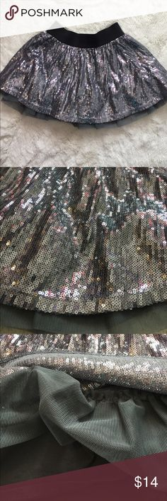 silver skirt Gorgeous silver sequin skirt super shiny with elasticized waist under skirt like new condition est. 1989 place Bottoms Skirts