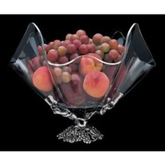 A graceful acrylic bowl perches atop a cast aluminum grapevine adorned with clusters of grapes and leaves.