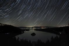 https://flic.kr/p/uq3FGG | Emerald Bay Star Trails [Explore 6/15/15] | Looking out over Emerald Bay during a quick but great birthday trip to South Lake Tahoe.  This part of the lake is breathtaking at any hour, but it gets mobbed during the day, so there was something extra-special about visiting after dark, sans crowds.  This is fifty-eight separate shots taken at 30sec, f/2.0, ISO 400 and stacked using StarStaX.      [Rokinon 16mm f/2.0]