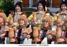 EVOLENE, SWITZERLAND - AUGUST 13: Yakutsk dancing group holding ceremonial cups at the International Festival of Folklore and Dance from the mountains (CIME) :  August 13, 2013 in Evolene Switzerland - stock photo