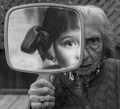 wonderful photo idea, part of photo from when young in mirror to old self standing behind......what we see in the mirror still through our eyes