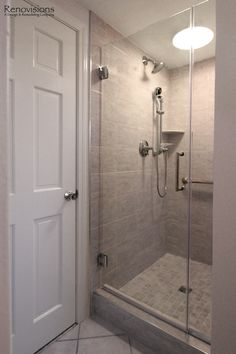 Bathroom remodel by Renovisions. Contemporary style, walk-in shower, tiled shower, handheld shower head, glass shower door, chrome fixtures