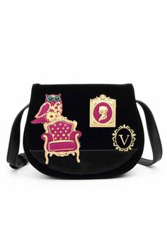 The Vendula Downton Saddle Bag and its gorgeous gold applique details make this accessory a real stand out item. The choice of purple woolen and pink tartan fabric or black faux suede and velvet fabric lend an elegant and quaint charm to this saddlebag. A cute owl embroidered in golden thread sits on a chair; its turquoise eyes ever watchful. On the back, an embroidered gold lamppost and a colorful bunch of flowers in a golden vase add to a perfect combination of British winter and classic…