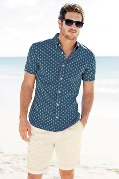 slate blue patterned shirt. cream colored shorts. shades. cool. summer. beach. weekend. style.
