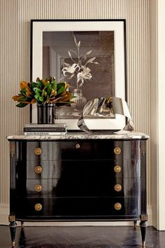 Chic black lacquer on this antique chest with a modern sculpture….It's all in the Mix