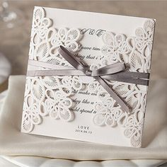 Shop laser cut wedding invitations at elegantweddinginvites, and admire the beauty and precision of each magnificent design. These invites are meant to impress!Invitation Card Dimensions:5.90 x 5.90 in (w x h)Response Card Dimensions:5.00 x 3.50 in (w x h)Reception Card Dimensions:3.937 x 3.937 in (w x h)Thank You Note:5.00 x 3.50 in (w x h)Outer Envelope:6.29 x 6.29 in (w x h)Envelopes for Other Cards:5.25 x 3.75 in (w x h)Please note, reception cards don't come with envelopes. If you ne...