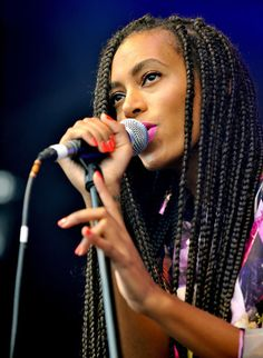 Solange Knowles: Solange Knowles rocked orange nails, pink lipstick, and multiple braids while performing during day two of Glastonbury.