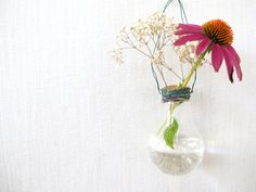 Hanging Lightbulb Vase  Hang a lightbulb from a wire and fill with water and small flowers.