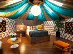 Love the draped fabrics on the ceiling