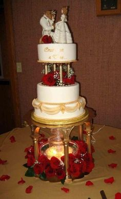 Beauty and beast Wedding cake white and gold with red roses