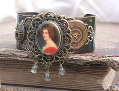 Handmade cuff bracelet.  Vintage watch parts, photos.  By Pepper Pod Designs by Beth Ingles (on Facebook)
