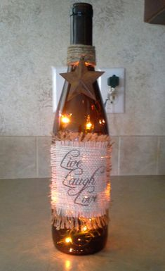Primitive Rustic Decor Live Laugh Love Recycled by rudiestreasures Glass Bottle Crafts, Wine Bottle Art, Painted Wine Bottles, Diy Bottle, Painted Wine Glasses, Light Up Bottles, Bottles And Jars, Alcohol Bottles, Wine Craft
