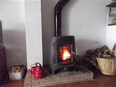 Wood burner and red enamel coffee pots