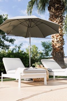 Modern, simple, and confident, the Eleya lounger's boxy silhouette makes for super supported lounging. An aluminum base holds up a weather-resistant cushion, cut from dense foam. Water and sag proof? This lounger does it all.Photo by The Love Designed Life. #OutdoorPatioIdeas #ModernPatio #PatioDesign #BackyardPatioDesigns
