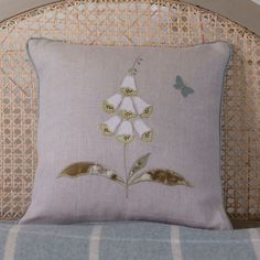 A beautiful and delicate free-hand machine embroidered cushion featuring a white foxglove Applique Cushions, Cute Cushions, Cushions To Make, Patchwork Cushion, Embroidered Cushions, Sewing Pillows, Wool Applique, Applique Quilts, Free Motion Embroidery