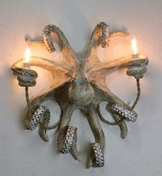 Make a statement with this Octopus Wall Sconce. No one can walk by this light fixture without saying WOW! Size measures aprx Long x wide x tall (or out from the wall). Each piece is unique and completely handmade. Available in two colors; Octopus Decor, Octopus Art, Arte Peculiar, Decoration Entree, Gothic House, Paperclay, Tentacle, Handmade Home Decor, Wall Sconces