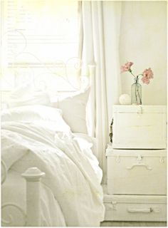 something about a white room & white bedding that equals serene & calming.