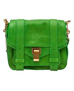 PS1 pouch bag in kelly green from Proenza Schouler. This leather bag features a back zip pocket, top flap, front buckle style straps, and a front lock. Has snap button pocket on the front, adjustable detachable shoulder strap, black lining, and a single internal zip pocket.
