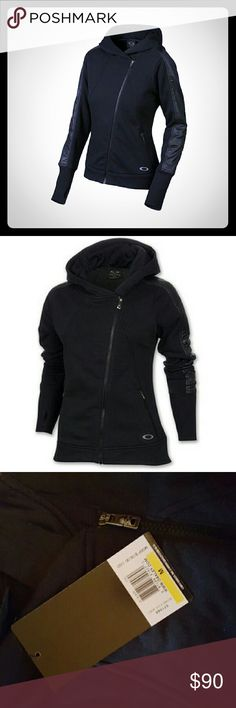 NWT Oakley Restore Zip Up Jacket Ladies black Oakley Restore zip up fleece jacket. Size Medium. Comfortable and cute!!  Asymmetrical zip for a unique modern look. Oakley logo embroidered on bottom. Brand new! Never worn!  Sold out & no longer in production. Oakley Jackets & Coats