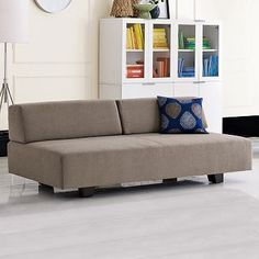 This is a sleeper sofa - removable back cushions for large group seating or bed.  Tillary Sofa  on westelm.com