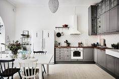 Gothenburg apartment with grey IKEA kitchen cabinets, white appliances, and a dark wood butcher block counter also from IKEA Grey Ikea Kitchen, Grey Shaker Kitchen, Grey Kitchens, Home Kitchens, Kitchen White, Swedish Kitchen, Kitchen Modern, Interior Design Examples, Scandinavian Interior Design