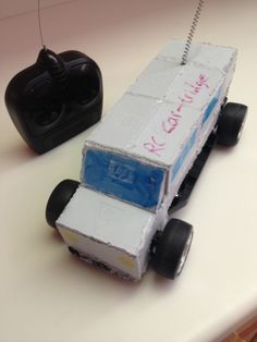 Remote controlled car with the body made entirely of used ink cartridges and motor parts from a non operational RC car. This vehicle is fully operational with the wireless remote.