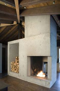 Nice concrete fireplace.  * All images courtesy of Olson Kundig Architects. In situ concrete fireplace and wood store. Strong rectilinear composition.