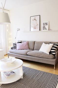 Valanti / Tikau / Vee Speers / Artemide Tolomeo Nice white walls. Graphic b&w rug with b&w cushions, pink, simple shapes