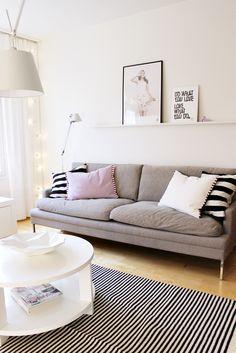 Valanti / Tikau / Vee Speers / Artemide Tolomeo Nice white walls. Graphic b&w rug with b&w cushions, pink, simple shapes