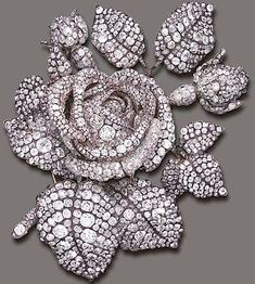 "FORMERLY THE PROPERTY OF PRINCESS MATHILDE (1820-1904)  THE TUDOR ROSE A MAGNIFICENT ANTIQUE DIAMOND CORSAGE BROOCH, BY THEODORE FESTER Designed as a large sculpted rose blossom, entirely decorated by old European, old mine and rose-cut diamonds, mounted in silver-topped gold, circa 1855, in a red leather fitted case According historical documents, the brooch is said to contain, ""2,637 brilliants for 136 carats and 860 little roses not weighed"""