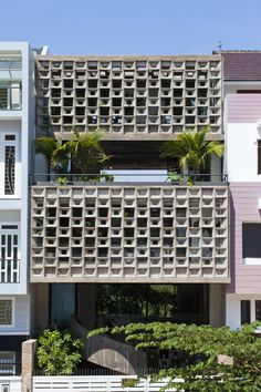 Concrete screen wall with a cool and interesting texture. Binh Thanh House / Vo Trong Nghia Architects + Sanuki + Nishizawa architects