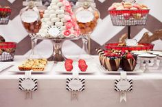 Pies, brownies, bars, cupcakes on a cake tray. I  like the stacked mini doughnuts. Glass domes, cake stands for pies.