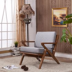 Add comfort and classic style to any space with the Solid Ash Club Arm Chair. This accent chair is crafted of solid Manchurian ash with soft textured fabric, creating a warm, inviting design.