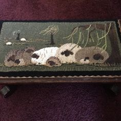 """New pattern called """"Ewe love willows"""" I placed it in a small wooden foot stool. Finished size is 7""""x14"""""""