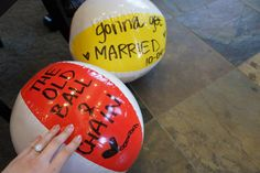 Couples Shower - Pool Party: Write wedding phrases on beach balls for a fun party decoration.