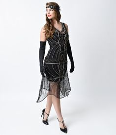 Paradise is a fabulous frock and a cold gin, dames! A dazzling reproduction flapper dress from Unique Vintage in a rich...Price - $248.00-VeEB5i36
