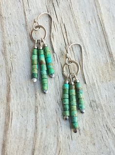 "Small, light weight genuine green turquoise dangles with an antiqued silver ring and silver plated ear wires. Approx 1.5"" in length."