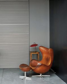 Arne Jacobsen egg chair teamed with a dark interior. Slightly masculine and seductive in this setting.