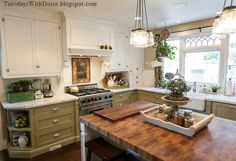 I like the corbels on the stove vent -The green paint color on the base cabinets is Bamboo Shoot by Sherwin Williams. The upper cabinets are painted Swiss Coffee (Dorie's favorite white), by Benjamin Moore. The wall color is Benjamin Moore's, Hush