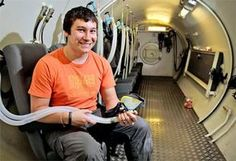 Eric Lokko in the  hyperbaric chamber  before one of his  sessions at the National  Hyperbaric Centre,  Dublin, was legally blind now can drive because of HBOT