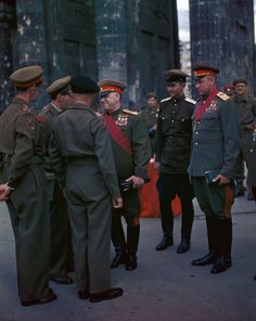 Field Marshals Georgi Zhukov, Konstantin Rokossovsky, and other Soviet officers greeting Field Marshal Bernard Montgomery and other British officers at the Brandenburg Gate, Berlin, Germany, 12 Jul 1945.