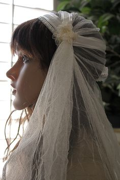 Juliet Bridal Cap Veil, 90 inch Ivory Crushed Tulle with satin ribbons by Las Vegas Veils. $185.00, via Etsy.