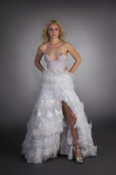 Feather Corset Gown from Oscar Fierro's Damas de Blanca Collection in 2011, for more designs visit www.OscarFierro.net