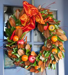 Persimmon-and-Pomegranate Leaf Wreath Use exotic fruits, such as persimmons and pomegranates, to add unexpected flair to a seasonal wreath. Nestled among waxy leaves and red branch trimmings, the fresh produce adds dimension to this fall wreath. To attach the fruit, simply work wire through center of the fruit, leaving extra wire to secure to garland. Tie a bow at the top of the wreath using burnt-sienna-color ribbon.