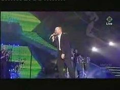 Phil Collins - You'll be in my heart!  From the first day we met ... and ... forevermore.  You'll always be in my heart!  :)